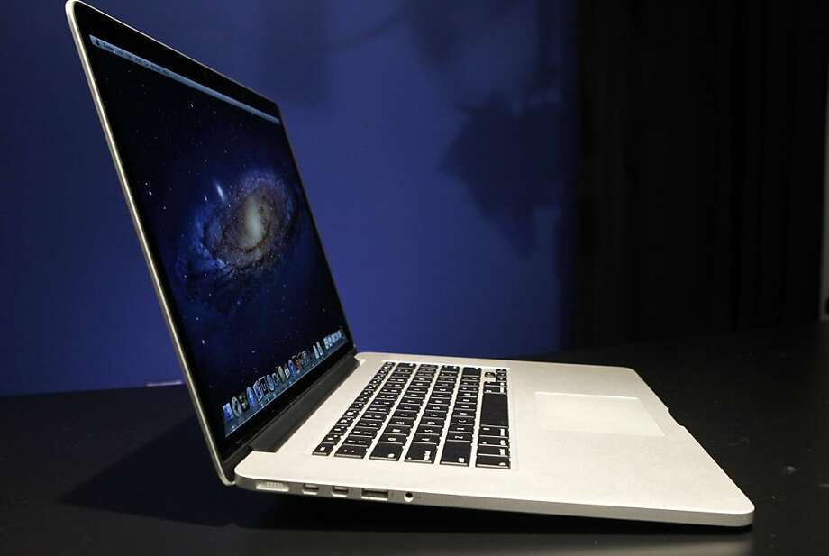 Apple is selling a new, less-expensive MacBook Pro with more flash storage in an effort to attract price-conscious consumers. Photo: Kathy Willens, Associated Press