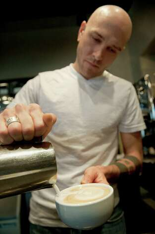 Joseph Duce of Olmos Perk uses a steady hand and keen eye to turn a hot drink into a work of latte art. Photo: Darren Abate, For The Express-News / San Antonio Express-News