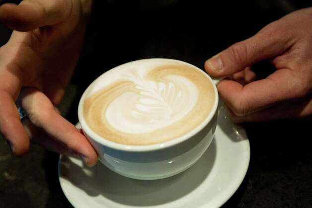 Barista Joseph Duce serves a latte, at Olmos Perk coffee shop, 5223 N. McCullough Ave. in Olmos Park. Photo: Darren Abate, Darren Abate/For The Express-New