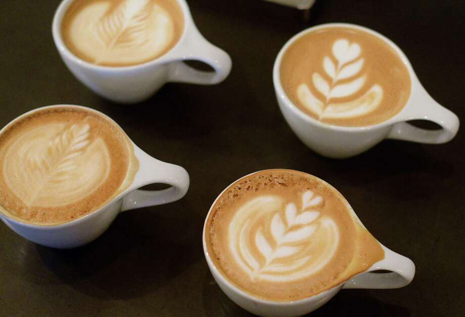Lattes at Local Coffee await judging. Scores are based on symmetry, contrast and harmony to the size of the cup. Photo: Billy Calzada, San Antonio Express-News / San Antonio Express-News