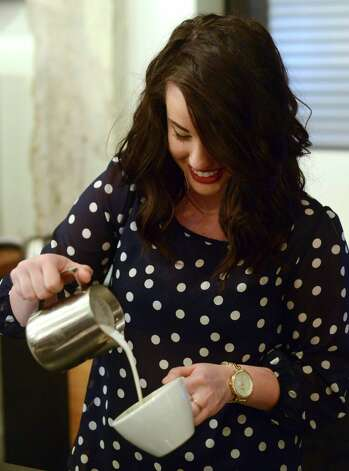 "Paige Arbogast pours a latte during the ""Latte Art Throwdown"" at Local Coffee on Wednesday, Feb. 6, 2013. Photo: Billy Calzada, San Antonio Express-News / San Antonio Express-News"