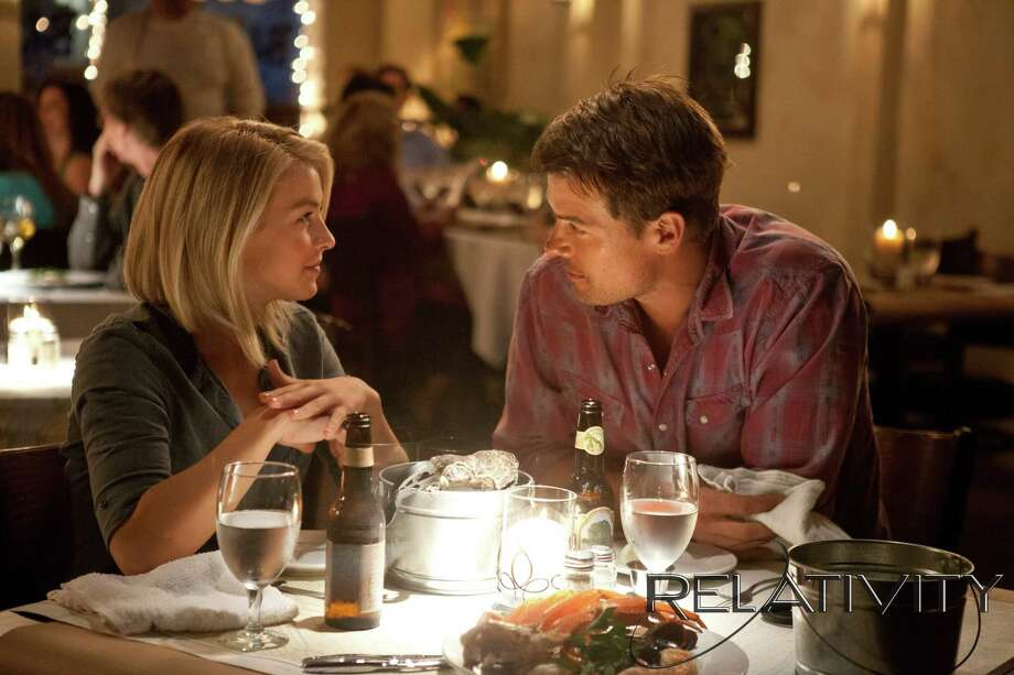 "Sparks fly when Katie (Julianne Hough) meets single dad Alex (Josh Duhamel) in ""Safe Haven."" Photo: James Bridges, Unit Photographer / ©2012 Safe Haven Productions. All Rights Reserved."
