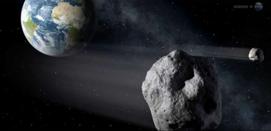This is a screengrab from NASA's video explaining just how close the asteroid will get. You can watch the video in this story: NASA says 150-foot asteroid to blow by Earth, real close