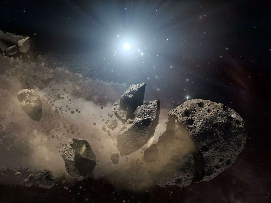 NASA imagines the asteroid that killed the dinosaurs as it breaks up in the asteroid belt and heads for Earth.
