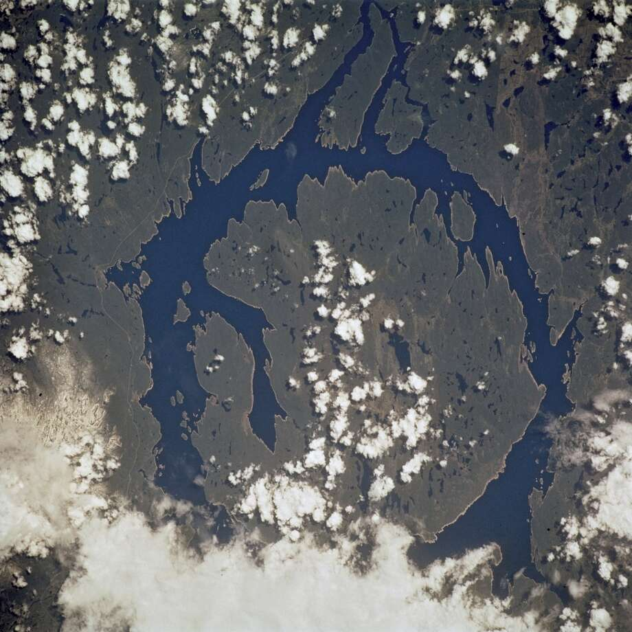 Manicouagan Crater, The Manicouagan Reservoir Crater In Quebec, Canada, Is One Of The Largest Meteorite Craters In The World, It Was Formed When The Earth Was Blasted By A Giant Meteorite At The End Of The Triassic Period Some 210 Million Years Ago.
