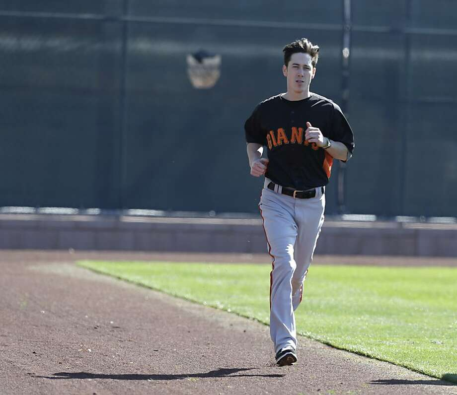 San Francisco Giants' Tim Lincecum runs during a spring training baseball workout Wednesday, Feb. 13, 2013, in Scottsdale, Ariz. (AP Photo/Darron Cummings) Photo: Darron Cummings, Associated Press