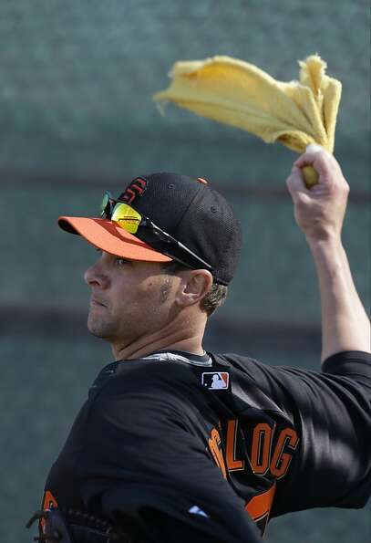 San Francisco Giants' Ryan Vogelsong throws during a spring training baseball workout Wednesday, Feb