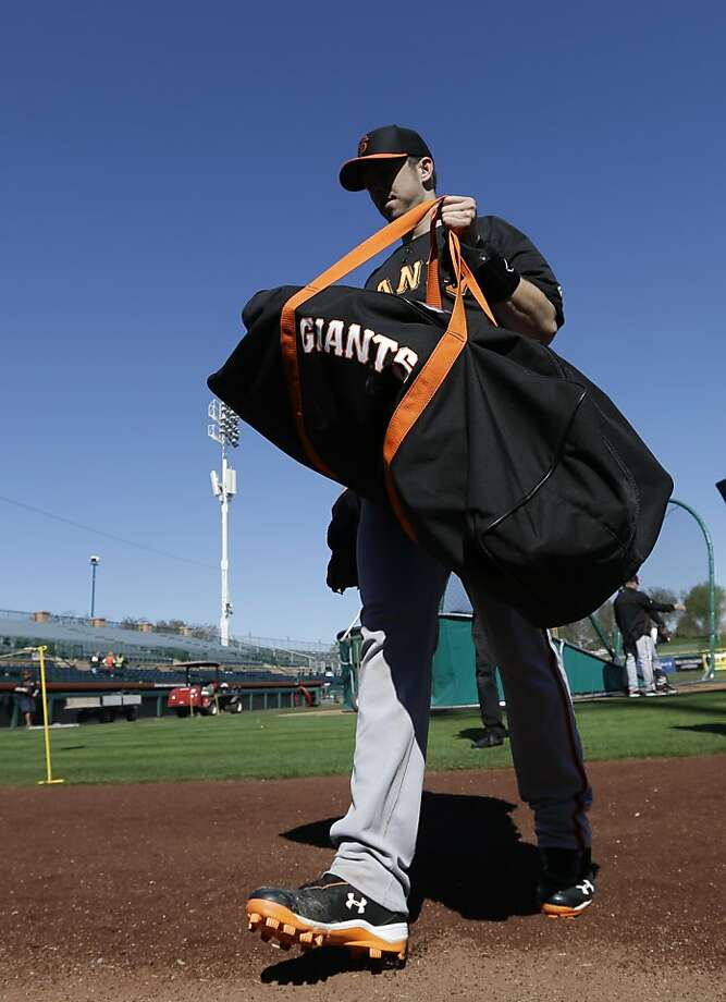 San Francisco Giants' Buster Posey walks to the dugout during a spring training baseball workout Wednesday, Feb. 13, 2013, in Scottsdale, Ariz. (AP Photo/Darron Cummings) Photo: Darron Cummings, Associated Press