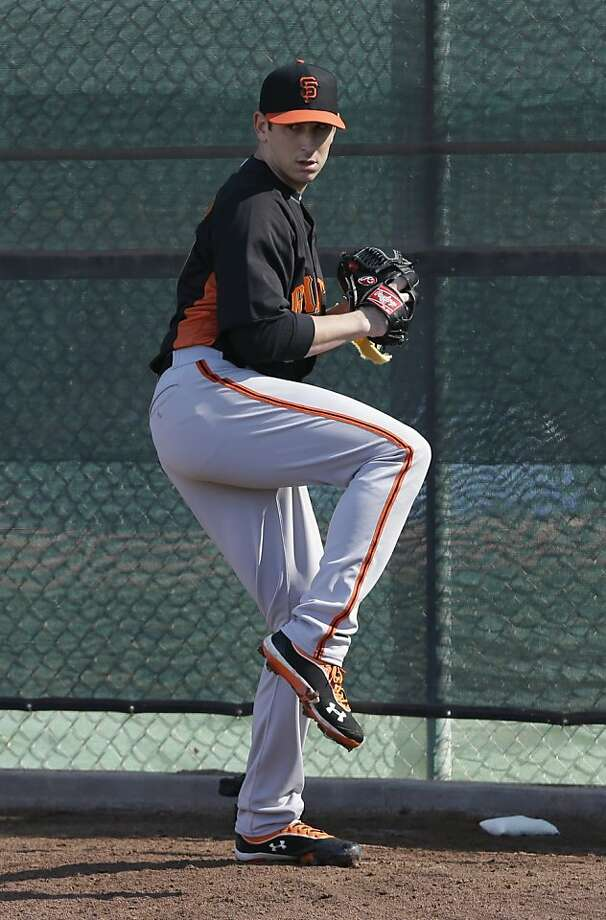 San Francisco Giants' Eric Surkamp throws during a spring training baseball workout Wednesday, Feb. 13, 2013, in Scottsdale, Ariz. (AP Photo/Darron Cummings) Photo: Darron Cummings, Associated Press