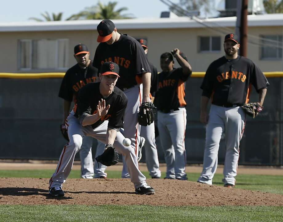 San Francisco Giants' Tim Lincecum fields a ball during a spring training baseball workout Wednesday, Feb. 13, 2013, in Scottsdale, Ariz. (AP Photo/Darron Cummings) Photo: Darron Cummings, Associated Press