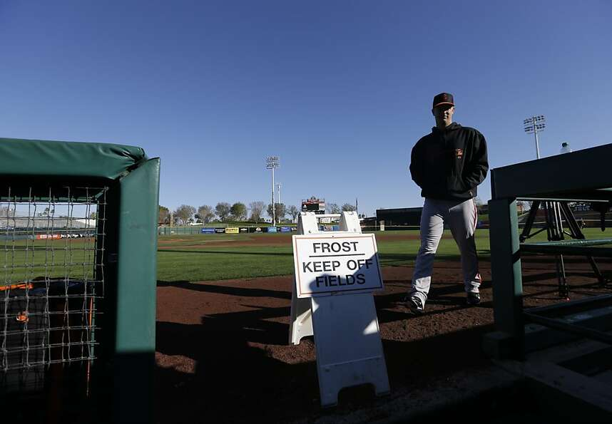 San Francisco Giants' Matt Cain walks to the dugout before a spring training baseball workout Wednes