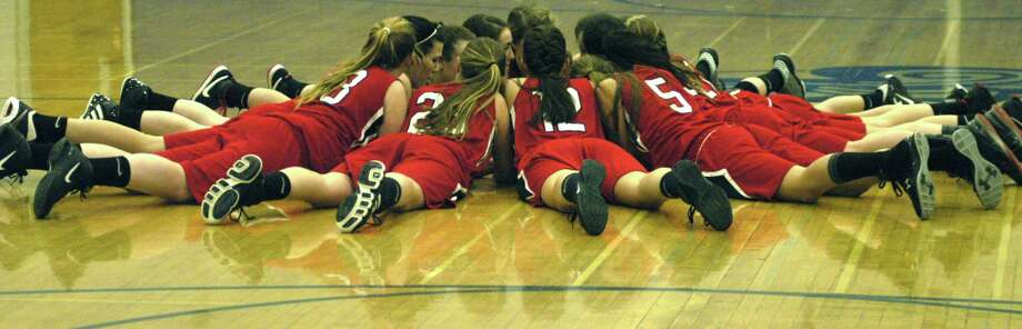 The Warriors offer their own version of a pre-game huddle before the Shepaug Valley High School girls' basketball game vs. visiting Wamogo, Feb. 1, 2013 in Washington. Photo: Norm Cummings