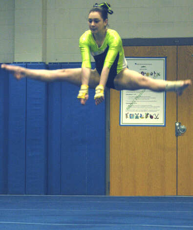 Briya Caceres of the Green Wave demonstrates her athleticism in floor exercise during a New Milford High School gymnastics meet vs. Oxford and Newtown at NMHS, Jan. 25, 2013 Photo: Norm Cummings
