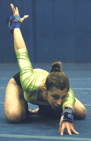 Kalee Oelgoetz of the Green Wave is primed for her floor exercise routine during a New Milford High School gymnastics meet vs. Oxford and Newtown at NMHS, Jan. 25, 2013 Photo: Norm Cummings