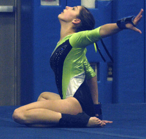 The Green Wave's Kalee Oelgoetz competes in floor exercise during a New Milford High School gymnastics meet vs. Oxford and Newtown at NMHS, Jan. 25, 2013 Photo: Norm Cummings