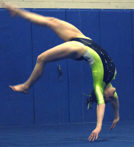 The Green Wave competes in floor exercise during a New Milford High School gymnastics meet vs. Oxford and Newtown at NMHS, Jan. 25, 2013 Photo: Norm Cummings