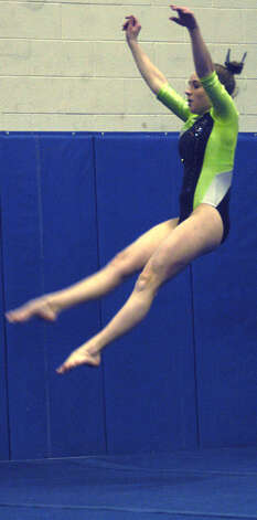 The Green Wave's Erica Davidson competes in floor exercise during a New Milford High School gymnastics meet vs. Oxford and Newtown at NMHS, Jan. 25, 2013 Photo: Norm Cummings