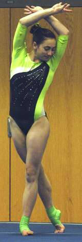 The Green Wave's Alison Profeta poises for her floor exercise routine during a New Milford High School gymnastics meet vs. Oxford and Newtown at NMHS, Jan. 25, 2013 Photo: Norm Cummings