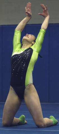 The Green Wave's Alison Profeta competes in floor exercise during a New Milford High School gymnastics meet vs. Oxford and Newtown at NMHS, Jan. 25, 2013 Photo: Norm Cummings