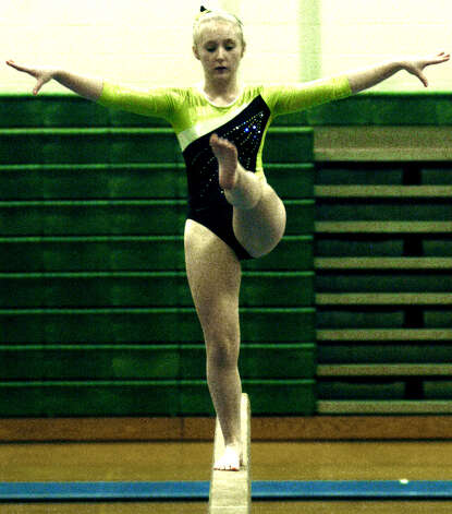 Green Wave freshman Kaitlyn McDonald displays her talents on balance beam for New Miford High School gymnastics during the South-West Conference championship meet at NMHS, Feb. 7,,2013 Photo: Norm Cummings
