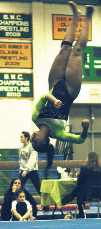 Ashley O'Berry of the Green Wave offers an entertaining floor exercise routine for New Miford High School gymnastics during the South-West Conference championship meet at NMHS, Feb. 7,,2013  for New Miford High School gymnastics during the South-West Conference championship meet at NMHS, Feb. 7,,2013 Photo: Norm Cummings