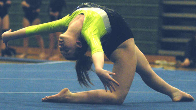 The energetic floor exercise routine of the Green Wave's Alyssa Grioli also featured moments of grace for New Miford High School gymnastics during the South-West Conference championship meet at NMHS, Feb. 7,,2013  for New Miford High School gymnastics during the South-West Conference championship meet at NMHS, Feb. 7,,2013 Photo: Norm Cummings