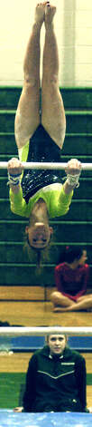 Alyssa Grioli of the Green Wave performs on uneven parallel bars for New Miford High School gymnastics during the South-West Conference championship meet at NMHS, Feb. 7,,2013  for New Miford High School gymnastics during the South-West Conference championship meet at NMHS, Feb. 7,,2013 Photo: Norm Cummings