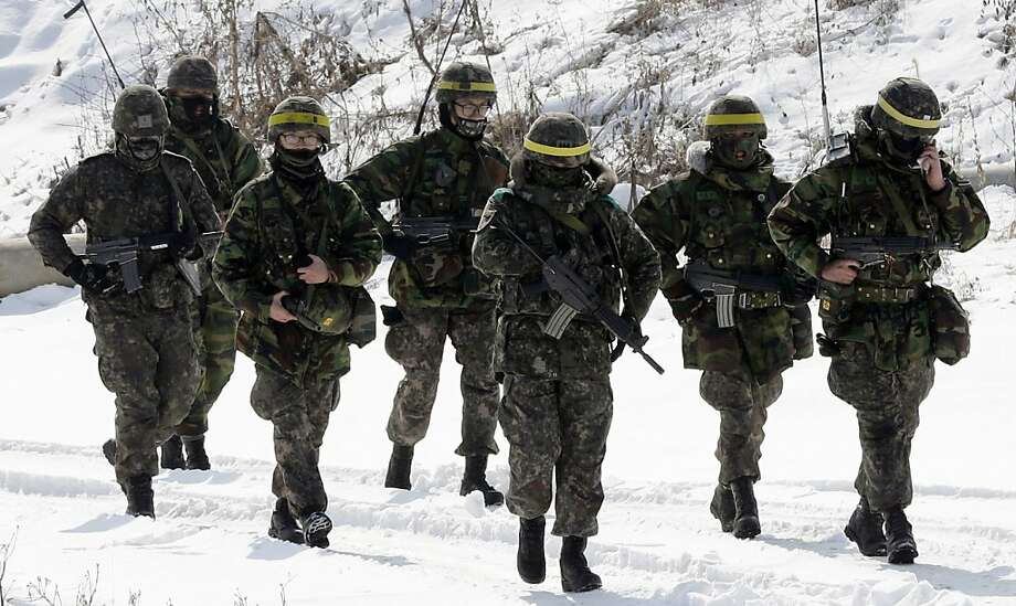 South Korean soldiers march on a lane covered with snow during a military drill in Paju near the demilitarized zone dividing the two Koreas on February 13, 2013. South Korea said on February 13 it would accelerate the development of longer-range ballistic missiles that could cover the whole of North Korea in response to a third nuclear test by Pyongyang.  REPUBLIC OF KOREA OUT  NO ARCHIVES  NO INTERNET    RESTRICTED TO SUBSCRIPTION USE     AFP PHOTO/YONHAPYONHAP/AFP/Getty Images Photo: Yonhap, AFP/Getty Images