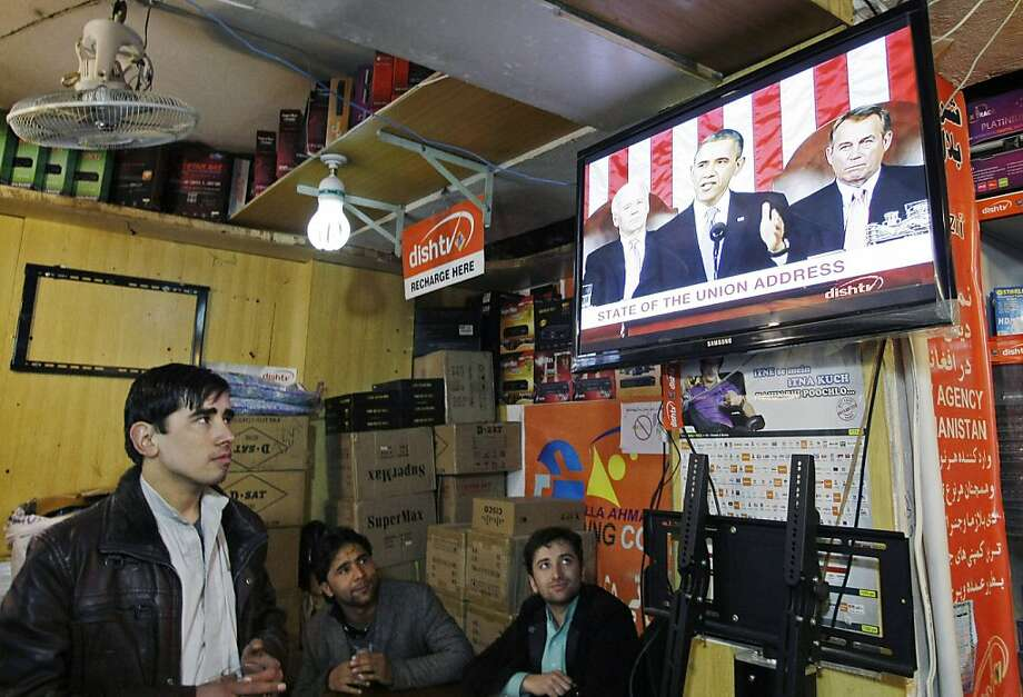 Men in Kabul watch a TV news report on President Obama's State of the Union address. The speech confirmed that U.S. troops are indeed leaving, sooner than expected. Photo: Musadeq Sadeq, Associated Press