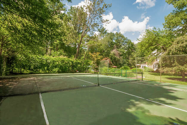 A tennis court awaits future homeowners and guests alike looking for some friendly competition or just some outdoor exercise. Photo: Robert Grusczynski/contributed P / Robert Grusczynski © 2012