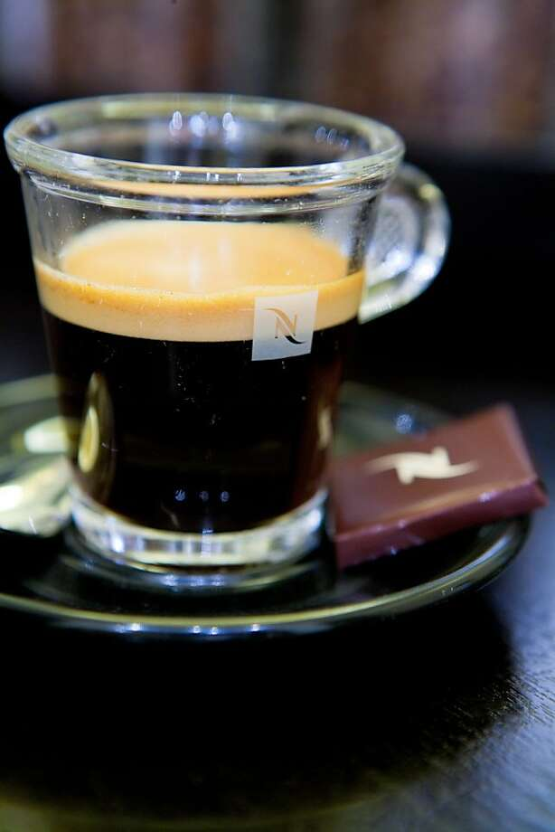 Fresh coffee is seen in a Nespresso glass at a Nestle SA Nespresso boutique in Dubai Mall, Dubai, United Arab Emirates, on Tuesday, Jan. 25, 2011. Nespresso's single-serve coffee and accessories, sold in more than 50 countries around the world, account for nearly 3 percent of Nestle's sales. Fresh coffee is seen in a Nespresso glass at a Nestle SA Nespresso boutique in Dubai Mall, Dubai, United Arab Emirates, on Tuesday, Jan. 25, 2011. Nespresso's single-serve coffee and accessories, sold in more than 50 countries around the world, account for nearly 3 percent of Nestle's sales and are expected to top 3 billion Swiss francs $3.1 billion) for 2010. Photographer: Duncan Chard/Bloomberg Photo: Duncan Chard, Bloomberg