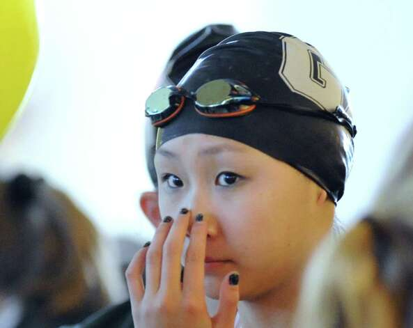 Greenwich Academy swimmer Hannah Hu, prior to swimming in the 200 IM during the high school swim meet at the YMCA of Greenwich, Wednesday afternoon, Feb. 13, 2013. Photo: Bob Luckey / Greenwich Time