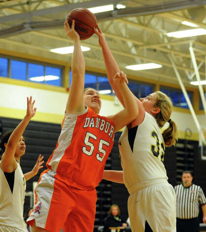 Trumbull's #32 Erin Moore blocks Danbury's #55 Melissa Peachman as she attempts a shot, during girls basketball action in Trumbull, Conn. on Wednesday February 13, 2013. Photo: Christian Abraham / Connecticut Post