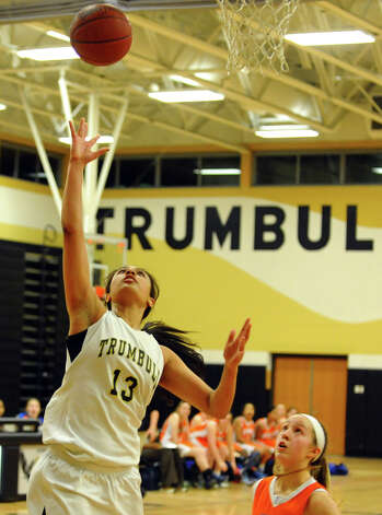 Trumbull's #13 Joyce Woolen lays up the ball, during girls basketball action against Danbury in Trumbull, Conn. on Wednesday February 13, 2013. Photo: Christian Abraham / Connecticut Post