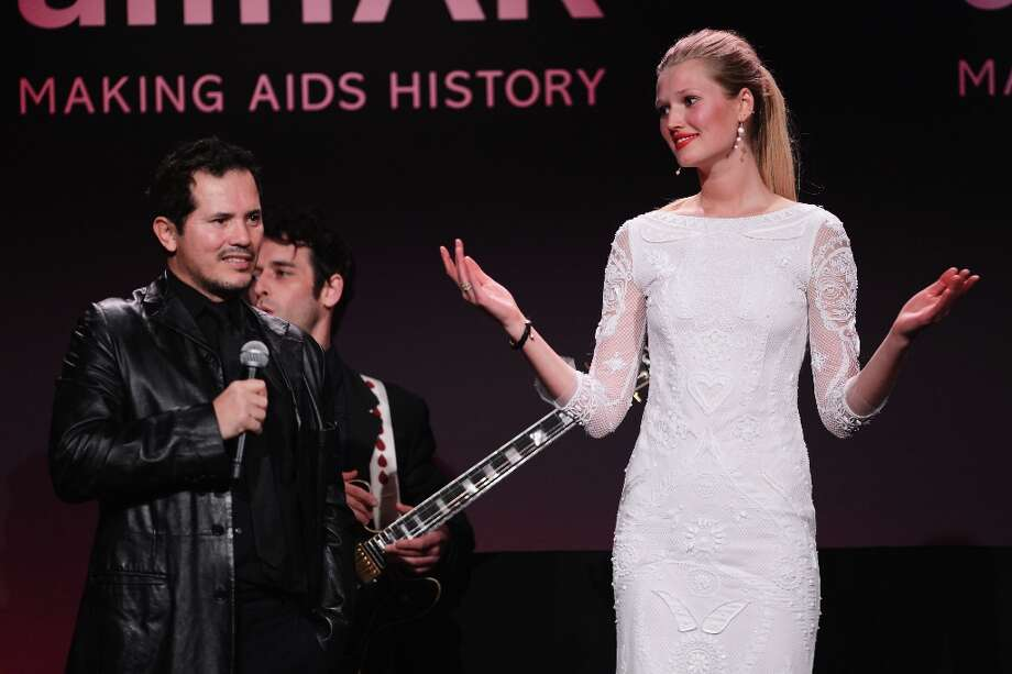 John Leguizamo and Toni Garrn speak onstage at the amfAR New York Gala to kick off Fall 2013 Fashion Week at Cipriani Wall Street on February 6, 2013 in New York City.  (Photo by Stephen Lovekin/Getty Images for Mercedes-Benz Fashion Week) Photo: Stephen Lovekin, (Credit Too Long, See Caption) / 2013 Getty Images