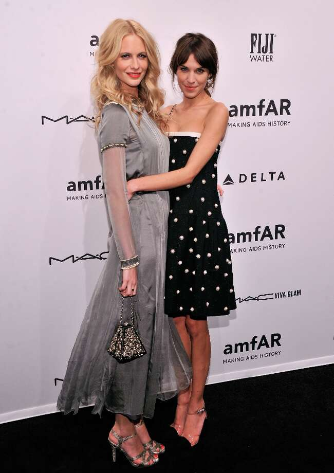 (L-R) Poppy Delevingne and Alexa Chung attend the amfAR New York Gala to kick off Fall 2013 Fashion Week at Cipriani Wall Street on February 6, 2013 in New York City.  (Photo by Stephen Lovekin/Getty Images for Mercedes-Benz Fashion Week) Photo: Stephen Lovekin, (Credit Too Long, See Caption) / 2013 Getty Images