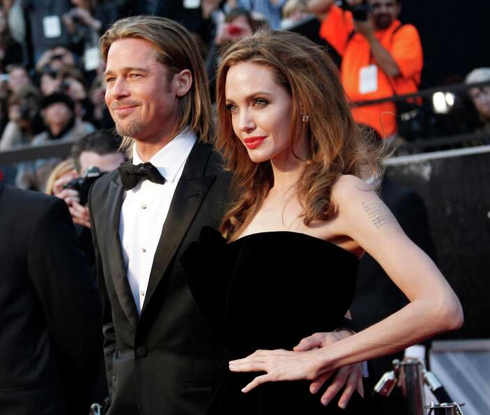 Actors Brad Pitt and Angelina Jolie arrive at the 84th Annual Academy Awards held at Hollywood & Hig