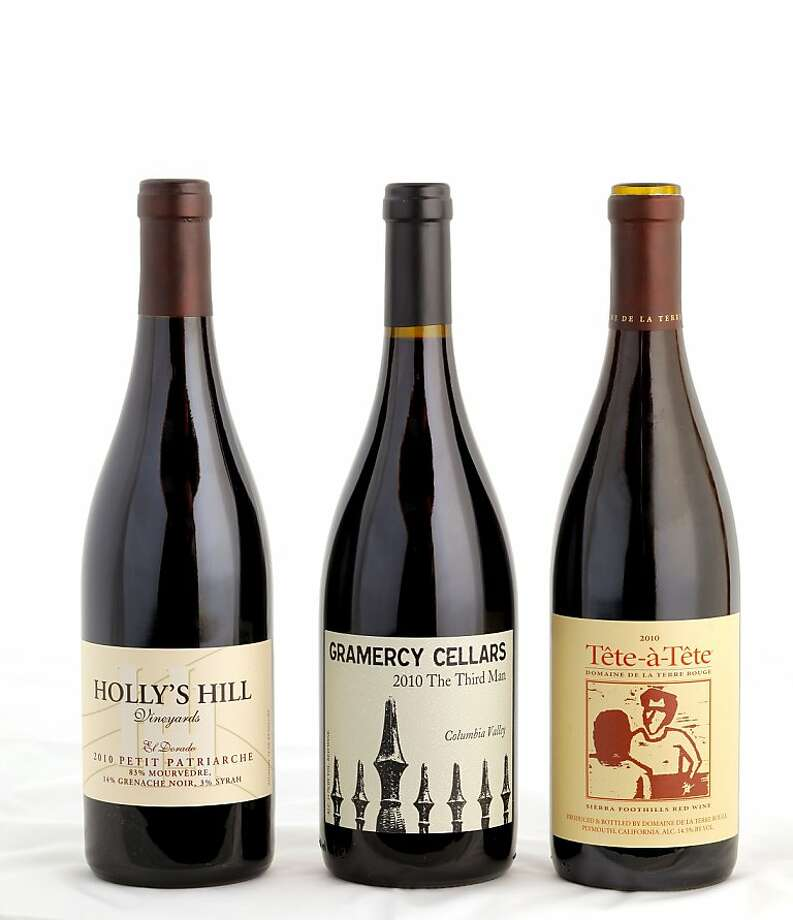 Left-right: 2010 Holly's Hill Vineyards Petit Patricarche, 2010 Gramercy Cellars The Third Man, 2010 Domaine de la Terre Rouge Tete-a-Tete as seen in San Francisco, California on Wednesday, February 6, 2013. Photo: Craig Lee, Special To The Chronicle
