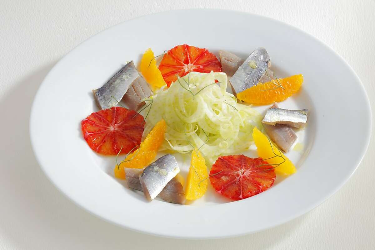 House pickled herring with witer citrus (from Sam's Chowder House executive chef/partner Lewis Rossman) as seen in San Francisco, California on Wednesday, February 6, 2013. Food styled by Simon F. F. Young.