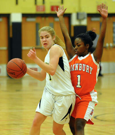 Trumbull's #1 Alexa Pfohl, left, looks to get around Danbury's #1 Nahla Ward, during girls basketball action in Trumbull, Conn. on Wednesday February 13, 2013. Photo: Christian Abraham / Connecticut Post