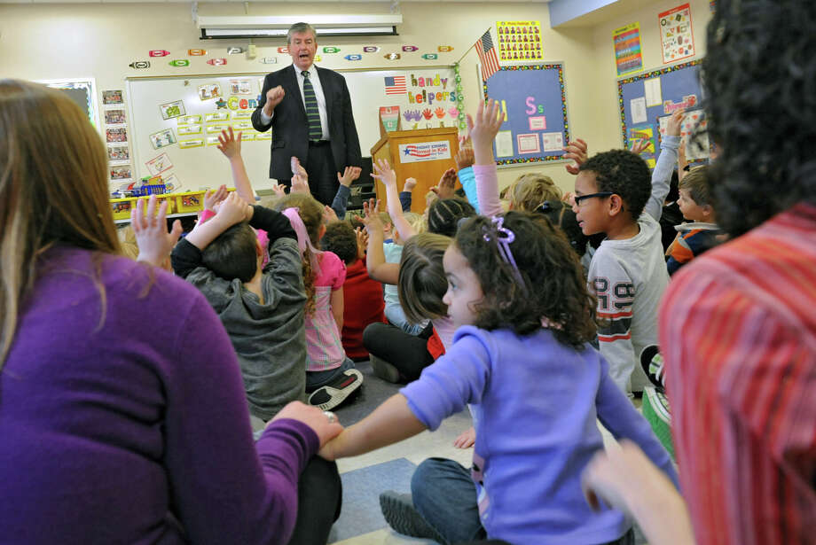 NYS Senator Neil Breslin talks to students in a Pre-K program at Abram Lansing Elementary School on Wednesday Feb. 13, 2013 in Cohoes, N.Y. The senator was explaining how important Pre-K programs are and how Gov. Cuomo is trying to get more funding for the programs. A Cohoes police officer read a book to the students.  (Lori Van Buren / Times Union) Photo: Lori Van Buren