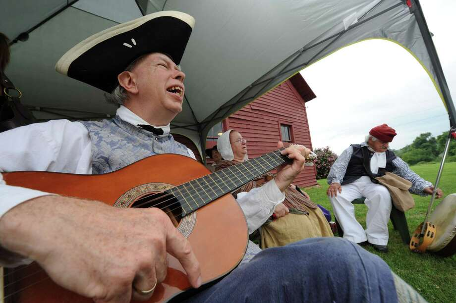 Bill Frueh, left, of the Rural Felicity 18th Century musicians group performs during the Knickerbocker Summer Festival at the Knickerbocker mansion in Schaghticoke NY Saturday July 28, 2012. The Knickerbocker Summer Festival also takes place Sunday July 29 10:00 am - 4:00 pm .(Michael P. Farrell/Times Union) Photo: Michael P. Farrell / 00018589A