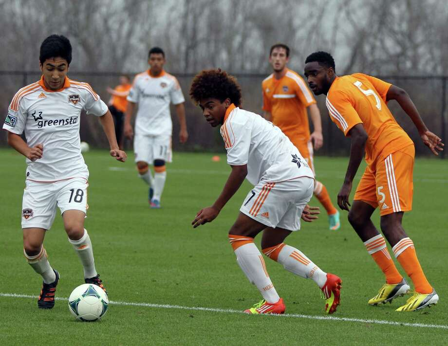 Bryan Salazar (white) and Warren Creavalle (Orange) in a friendly between the Dynamo and Dynamo Academy. Photo: Nigel Brooks