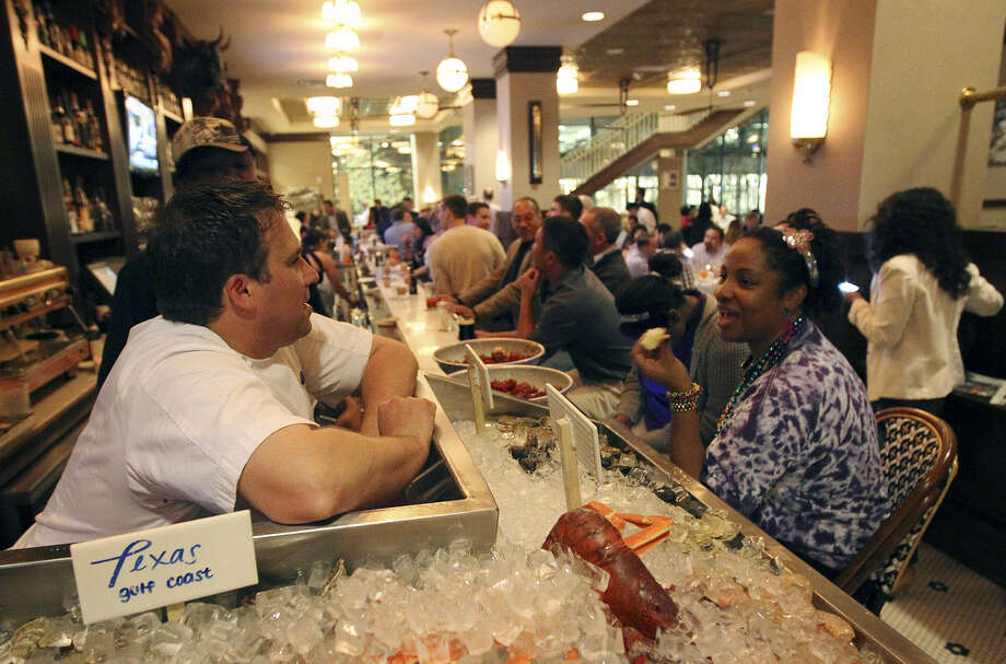 """Diner Amy Batiste (right) visits with Lüke chef John Russ on a recent Tuesday. """"We're seeing an extra 750 (people) each Tuesday visiting downtown,"""" Councilman Diego Bernal says. """"For a new program that's just getting started ... that's tremendous."""" Photo: Photos By Kin Man Hui / San Antonio Express-News"""