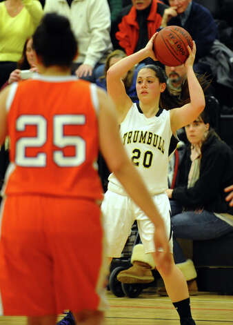 Trumbull's #20 Lauren Hyde looks to pass the ball, during girls basketball action against Danbury in Trumbull, Conn. on Wednesday February 13, 2013. Photo: Christian Abraham / Connecticut Post