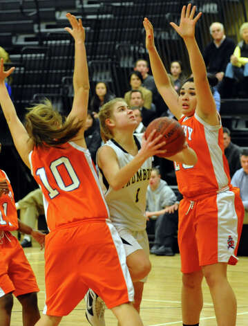 Trumbull's #1 Alexa Pfohl goes between two Danbury players to attempt a shot, during girls basketball action in Trumbull, Conn. on Wednesday February 13, 2013. Photo: Christian Abraham / Connecticut Post