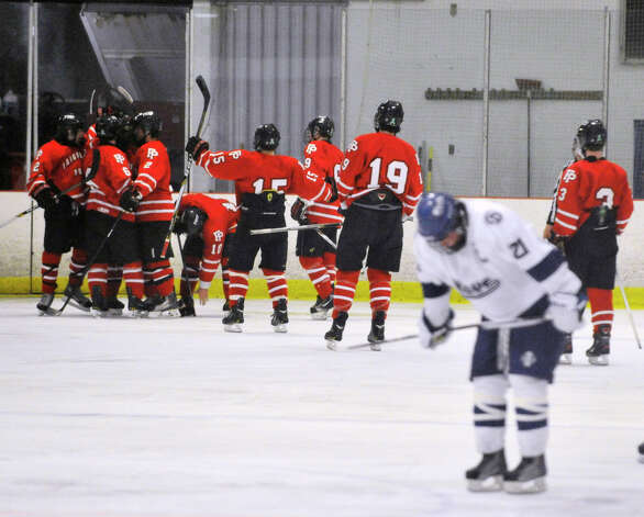 Fairfield Prep celebrates after a goal during their game against Darien at Darien Ice Rink on Wednesday, Feb. 13, 2013. Fairfield Prep won, 6-0. Photo: Jason Rearick / The News-Times