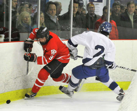 Fairfield Prep's Nick Bargiello is tripped up by Darien's Nicholas Allam during their game at Darien Ice Rink on Wednesday, Feb. 13, 2013. Fairfield Prep won, 6-0. Photo: Jason Rearick / The News-Times