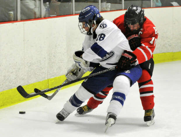 Darien's Kevin Love shields the puck from Fairfield Prep's Connor Henry during their game at Darien Ice Rink on Wednesday, Feb. 13, 2013. Fairfield Prep won, 6-0. Photo: Jason Rearick / The News-Times