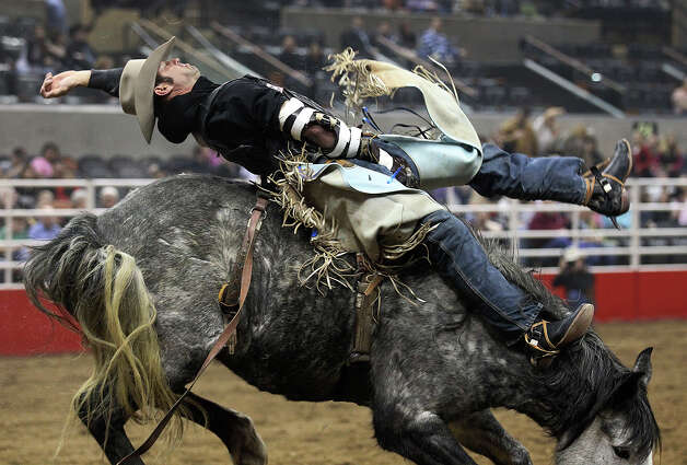 Steven Anding from Athens, Texas competes in the bareback riding competition at the 2013 San Antonio Stock Show and Rodeo on Wednesday, Feb. 13, 2013. Photo: Kin Man Hui, San Antonio Express-News / © 2012 San Antonio Express-News